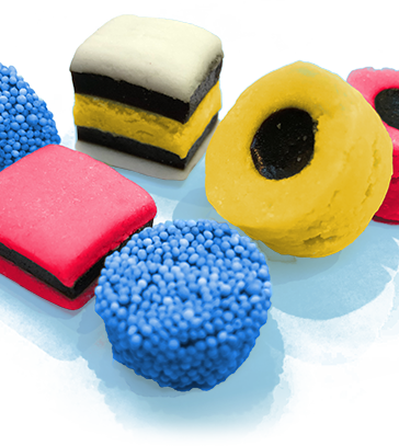 selection of liquorice allsorts in pink, yellow and blue