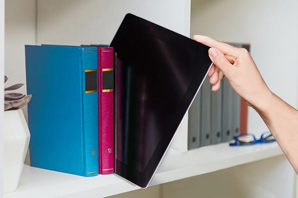 publishing industry digital publishing ipad on bookcase