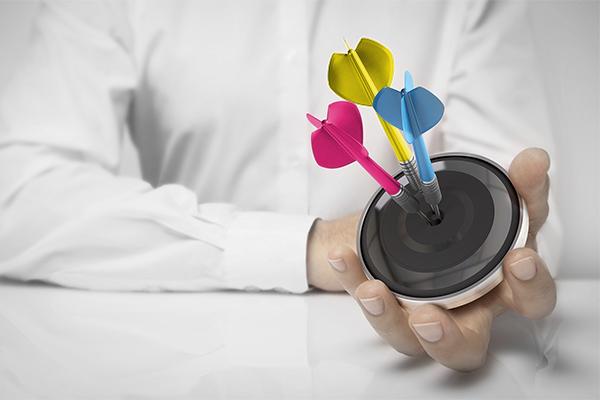 corporate branding hand holding coloured darts